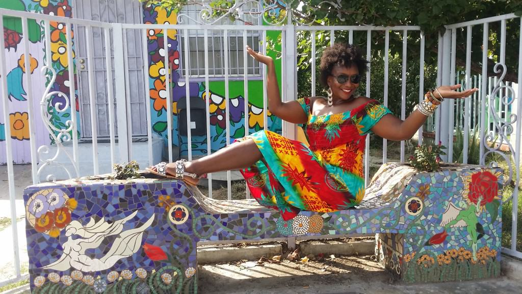 Posing on a colorful bench across the street from Watts Towers