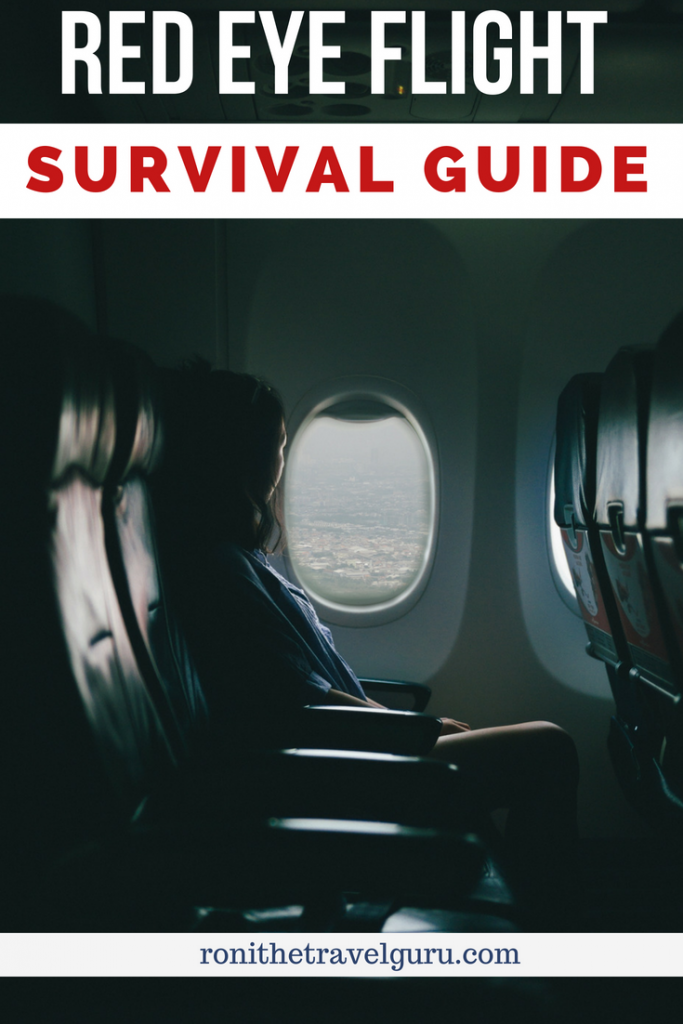 red eye flight tips for traveling - woman looking out a window on a plane