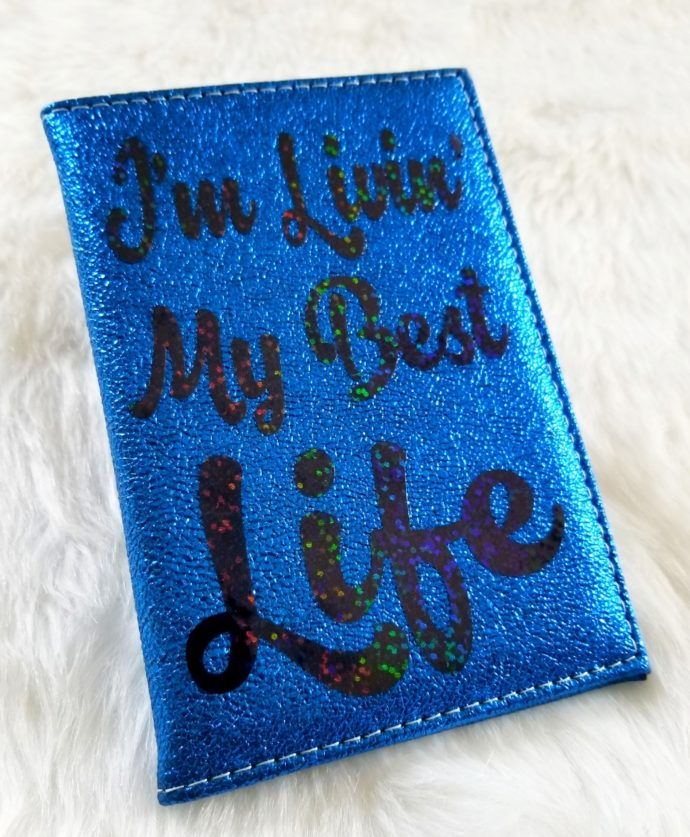 "Blue Passport Cover with Black writing ""I'm Living My Best Life"""