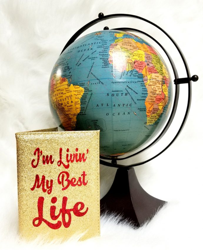 "Gold Passport Cover with Red writing ""I'm Living My Best Life"""